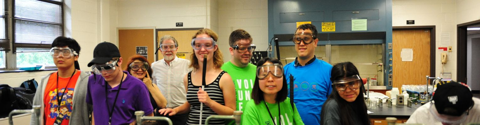 A group of blind students in a science lab poses for a picture.